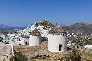 A Typical Greek Village Perched on a Rock with White and Blue Houses and Quaint Windmills, Ios by Roberto Moiola