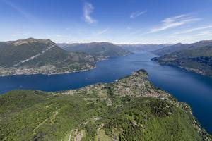 Aerial View of the Village of Bellagio Frames by the Blue Water of Lake Como on a Sunny Spring Day by Roberto Moiola