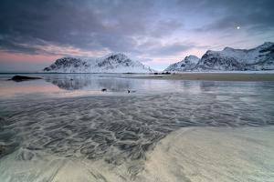 Black Sand and Full Moon as Surreal Scenery at Skagsanden Beach, Flakstad, Nordland County by Roberto Moiola