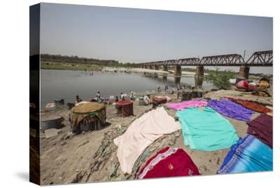 Colorful Clothes Drying in the Sun on the Banks of the River Yamuna