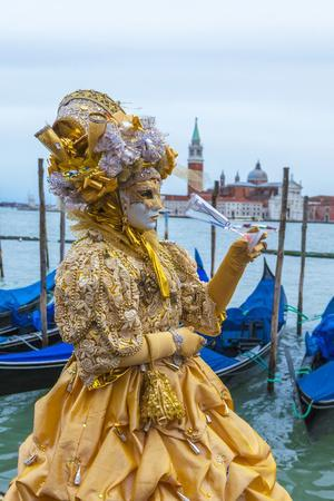 Colourful mask and costume of the Carnival of Venice, famous festival worldwide, Venice, Veneto, It