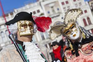 Colourful masks and costumes of the Carnival of Venice, famous festival worldwide, Venice, Veneto,  by Roberto Moiola