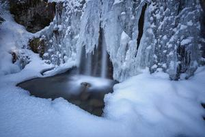Details of a waterfall framed by ice and snow, Switzerland, Europe by Roberto Moiola