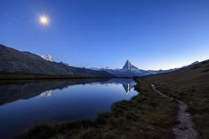 Full Moon and Matterhorn Illuminated for the 150th Anniversary of the First Ascent, Swiss Alps by Roberto Moiola