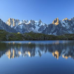 Grandes Jorasses and Dent Du Geant Reflected at Sunrise in Lac Des Cheserys by Roberto Moiola