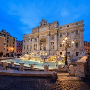 Panorama of Trevi Fountain Illuminated by Street Lamps and the Lights at Dusk, Rome, Lazio by Roberto Moiola