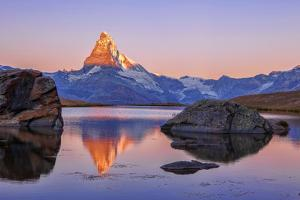 Pink Sky at Sunrise on the Matterhorn Reflected in Stellisee by Roberto Moiola
