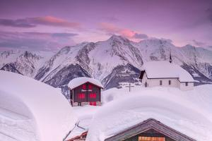 Pink Sky at Sunset Frames the Snowy Mountain Huts and Church, Bettmeralp, District of Raron by Roberto Moiola