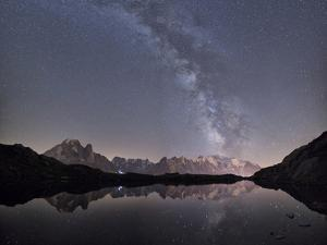 Starry Sky over Mont Blanc Range Seen from Lac Des Cheserys, Haute Savoie. French Alps, France by Roberto Moiola