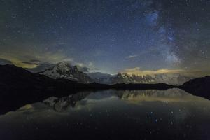 Stars and Milky Way Illuminate the Snowy Peaks and Lac De Cheserys, France by Roberto Moiola