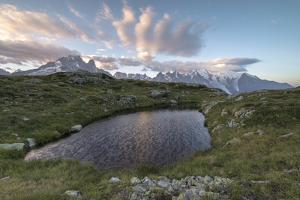 Sunrise on Mont Blanc massif seen from Lacs De Cheserys, Chamonix, Haute Savoie, French Alps, Franc by Roberto Moiola
