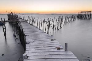Sunset at Palafito Pier of Carrasqueira, Natural Reserve of Sado River, Alcacer Do Sal by Roberto Moiola