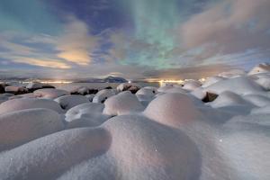 The Aurora Borealis (Northern Lights) Illuminate Snowy Landscape on a Starry Night Stronstad by Roberto Moiola