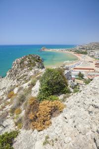 The cliffs frame the turquoise sea and the sandy beach of Licata, Province of Agrigento, Sicily, It by Roberto Moiola