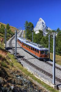 The Swiss Bahn Train Runs on its Route with the Matterhorn in the Background, Switzerland by Roberto Moiola
