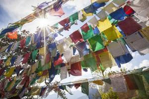 The Tibetan Prayer Flags Made of Colored Cloth by Roberto Moiola