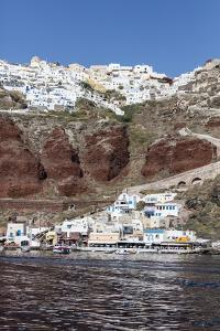 Typical Greek Village Perched on Volcanic Rock with White and Blue Houses and Windmills, Santorini by Roberto Moiola