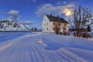 Typical House Surrounded by Snow on a Cold Winter Day at Dusk by Roberto Moiola
