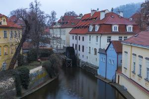 Typical houses on water canal frame the old mill of Certovka, Lesser Quarter, Prague, Czech Republi by Roberto Moiola