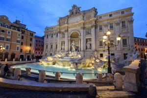 View of Trevi Fountain Illuminated by Street Lamps and the Lights of Dusk, Rome, Lazio by Roberto Moiola