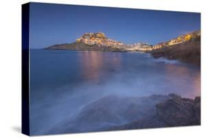 Waves frame the village perched on promontory at dusk, Castelsardo, Gulf of Asinara, Italy by Roberto Moiola