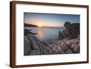 White cliffs and blue sea framed by the lights of sunset Santa Teresa di Gallura, Sardinia, Italy by Roberto Moiola