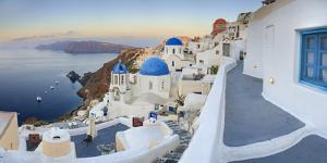 White Houses and Blue Domes of the Churches Dominate the Aegean Sea, Oia, Santorini by Roberto Moiola