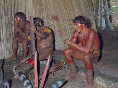 Kamayura Indians Playing Flutes Inside Hut, Xingu Area, Brazil, South America