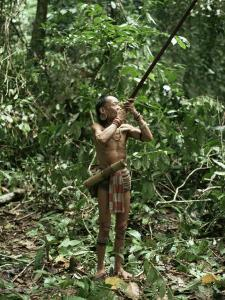 Member of the Penan Tribe with Blowpipe, Mulu Expedition, Sarawak, Island of Borneo, Malaysia by Robin Hanbury-tenison