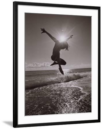 Silhouette of Dancer Jumping Over Atlantic Ocean