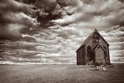 Abandoned Church in the Desert, with Stormy Skies