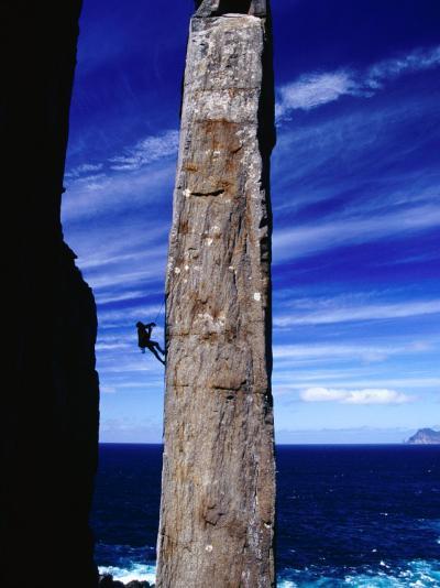 Rock-Climber Ascending the Totem Pole Rock Stack on the Tasman Peninsula, Australia-Grant Dixon-Photographic Print