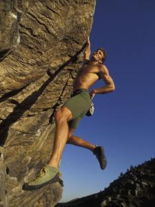 Rock Climber Hanging from Grip