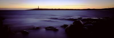 Rock Formations in the Sea with a Lighthouse in the Background, Cape Leeuwin, Western Australia--Photographic Print