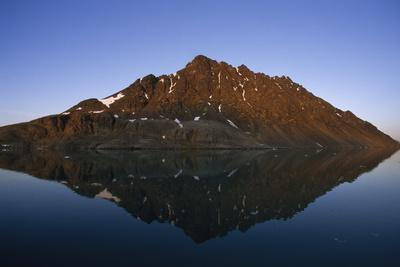 https://imgc.artprintimages.com/img/print/rock-mountain-in-a-fjord-reflected-in-the-calm-sea_u-l-q12wzoy0.jpg?p=0