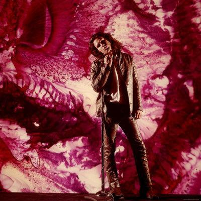 https://imgc.artprintimages.com/img/print/rock-star-jim-morrison-of-the-doors-standing-alone-in-front-of-a-purple-psychedelic-backdrop_u-l-p43ak10.jpg?p=0