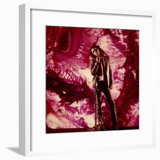 Rock Star Jim Morrison of the Doors Standing Alone in Front of a Purple Psychedelic Backdrop-Yale Joel-Framed Premium Photographic Print