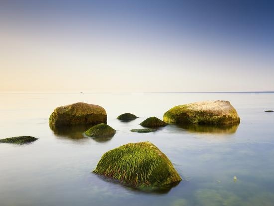Rocks in Shallow Water of Baltic Sea-Frank Lukasseck-Photographic Print