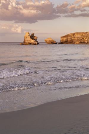 https://imgc.artprintimages.com/img/print/rocky-coast-with-stone-pillars-the-mediterranean-sea-apulia-italy_u-l-q1byvxc0.jpg?p=0