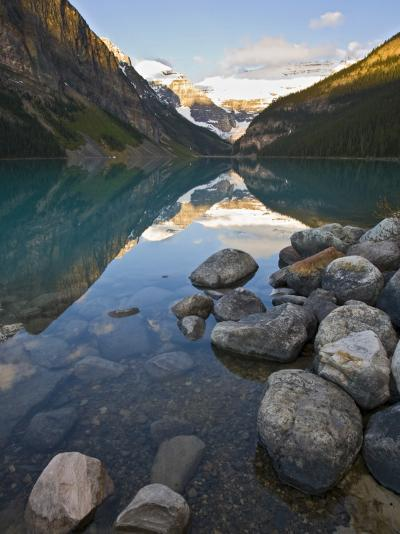 Rocky Mountains and Boulders Reflected in Lake Louise, Banff National Park, Alberta, Canada-Larry Ditto-Photographic Print