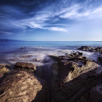 Rocky Shore and Tranquil Sea, Portoscuso, Sardinia, Italy--Photographic Print