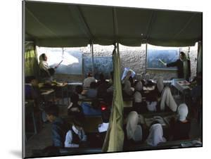 Afghan Teachers Give a Language Lesson to Boys and Girls by Rodrigo Abd