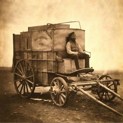 Marcus Sparling, Lull-Length Portrait, Seated on Roger Fenton's Photographic Wagon, 1855