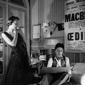 Jean Cocteau Sketching Model Elizabeth Gibbons in a Chanel Dress in His Hotel Bedroom by Roger Schall
