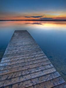 Sunset Over a Wooden Wharf on Lake Audy, Riding Mountain National Park, Manitoba, Canada by Rolf Hicker