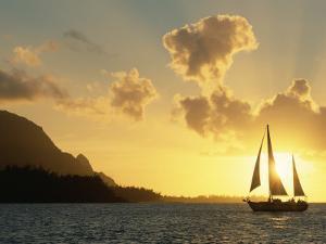 Sailing Yacht at Sunset off Coast of Hanalai Bay, Kauai, Hawaii, USA by Rolf Nussbaumer