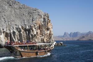 Dhow in Musandam Fjords, Oman, Middle East by Rolf Richardson