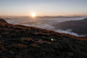 Sunrise Above a Sea of Clouds, Alps, South Tirol by Rolf Roeckl