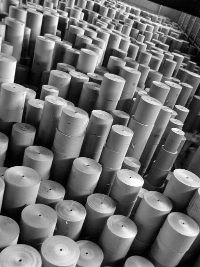 Rolls of Kraft Paper to Be Made into Paper Sacks Sit Stacked in the Union Bag and Paper Corp. Plant-Margaret Bourke-White-Photographic Print