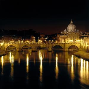 Night View of the Sant'Angelo Bridge and the Dome of the Basilica of Saint Peter in Rome by Roman